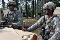 Army Staff Sgt. Irshaad Mohamed, right, discusses mission requirements with Spc. Trazile Marckensom during training at the Joint Readiness Training Center, Fort. Polk, La., July 25, 2016. Mohamed is an infantryman and section leader assigned to the New York Army National Guard's Co. D, 1st Battalion, 69th Infantry Regiment. Army National Guard photo by Sgt. Maj. Corine Lombardo