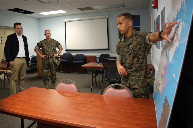Gunnery Sgt. Louie Cruz (right) explains how the area around the air station is used for training purposes to Chad Sydnor (left) and Col. Chris Pappas III at Marine Corps Air Station Cherry Point, N.C., July 19, 2016. Sydnor, the military legislative assistant for U.S. Sen. Richard Burr, visited Cherry Point to become more familiar with the air station's mission and issues within Burr's purview. Sydnor visited various places on the air station, including Fleet Readiness Center East, the Air Traffic Control tower, and the Devil Dog Gym. Pappas is the commanding officer of MCAS Cherry Point and Cruz is the radar chief with Headquarters and Headquarters Squadron. (U.S. Marine Corps photo by Lance Cpl. Mackenzie Gibson/Released)