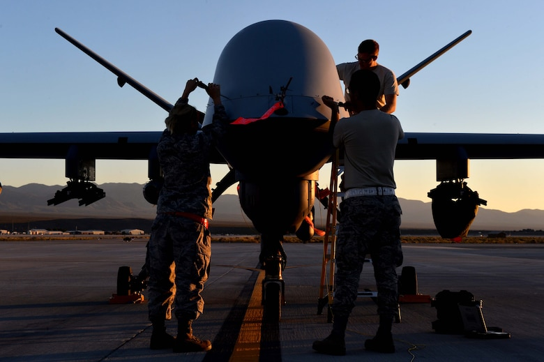 Airmen from the 432nd Wing/ 432nd Air Expeditionary Wing perform maintenance on an MQ-9 Reaper in preparation to support Red Flag 16-3 July 20, 2016, at Creech Air Force Base, Nevada. The exercise incorporates a wide range of training for air, space, and cyber systems that prepare Airmen for future operations. (U.S. Air Force photo by Airman 1st Class Kristan Campbell/Released)