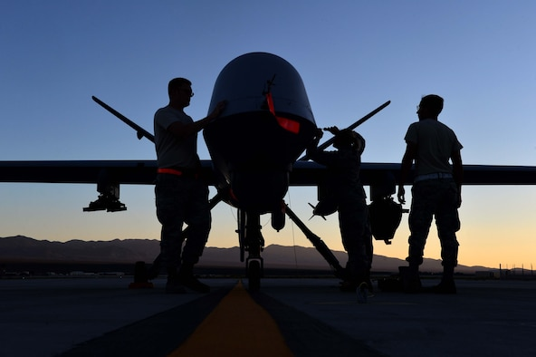 Airmen from the 432nd Aircraft Maintenance Squadron perform maintenance on an MQ-9 Reaper in preparation to support Red Flag 16-3 July 20, 2016, at Creech Air Force Base, Nevada. The exercise also incorporates aircraft platforms from U.S. military services and coalition partners in a variety of training scenarios. U.S. Air Force photo by Airman 1st Class Kristan Campbell/Released)