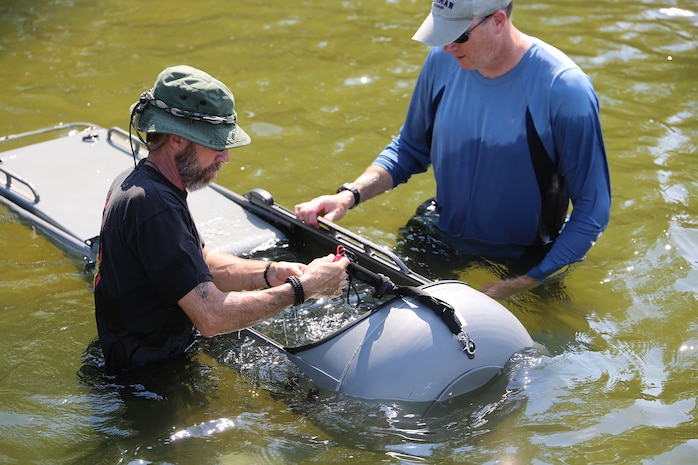 Ed Maziarski (left) and Jake Feeney of Reconnaissance and Amphibious Raids at Marine Corps Systems Command prepare a Diver Propulsion Device for testing July 18 at Lake Anna in Spotsylvania, Va. The team worked with Marine combatant divers to conduct tests of potential upgrades to the DPD to improve its speed and controllability. (U.S. Marine Corps photo by Monique Randolph)
