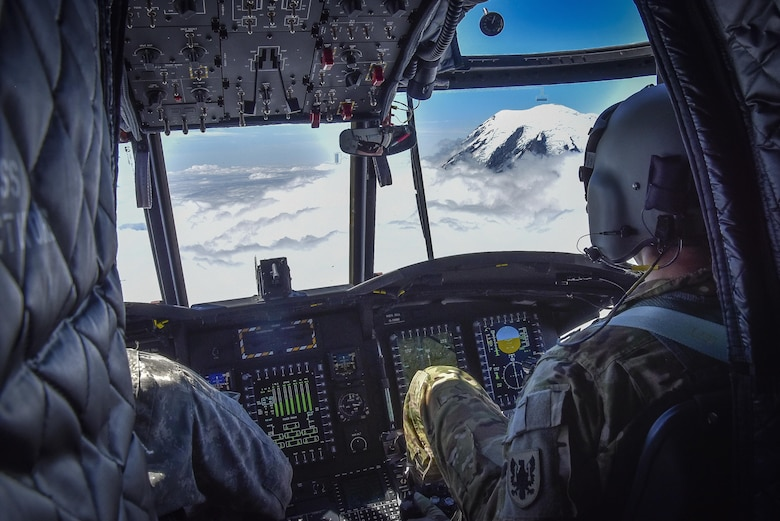 U.S. Army Reserve Chief Warrant Officer 3 Brian Pavlik, 1-214th General Support Aviation Battalion, Bravo Company, keeps a watchful eye during a flyover near Mount Rainier, Wash., onboard a CH-47 Chinook, July 22, 2016.  The 1-214th GSAB, has a unique mission which involves working with the Washington National Park  and provides support for search and rescue missions as well as fire rescue missions in the area.  (U.S. Army photo by Master Sgt. Marisol Walker/Released)