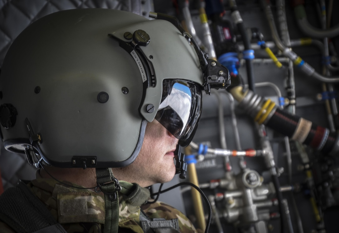 U.S. Army Reserve Sgt. Dan Glenn, 1-214th General Support Aviation Battalion, Bravo Company, enjoys the view during a flyover near Mount Rainier, Wash., onboard a CH-47 Chinook, July 22, 2016.  The 1-214th GSAB, has a unique mission which involves working with the Washington National Park  and provides support for search and rescue missions as well as fire rescue missions in the area. (U.S. Army photo by Master Sgt. Marisol Walker/Released)