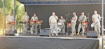 The 451st Army Rock Band begins their show as part of the summer concert series hosted by staff of the Directorate of Family and Morale, Welfare and Recreation at the Warrior Zone July 15. The concert was part of a welcome home celebration for the 2nd Armored Brigade Combat Team.