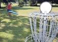 Scott Peavy, base recreation assistant, plays a round of disc golf at the Robins course. Peavy is also part of a disc golf league. (U.S. Air Force photo by Tommie Horton)