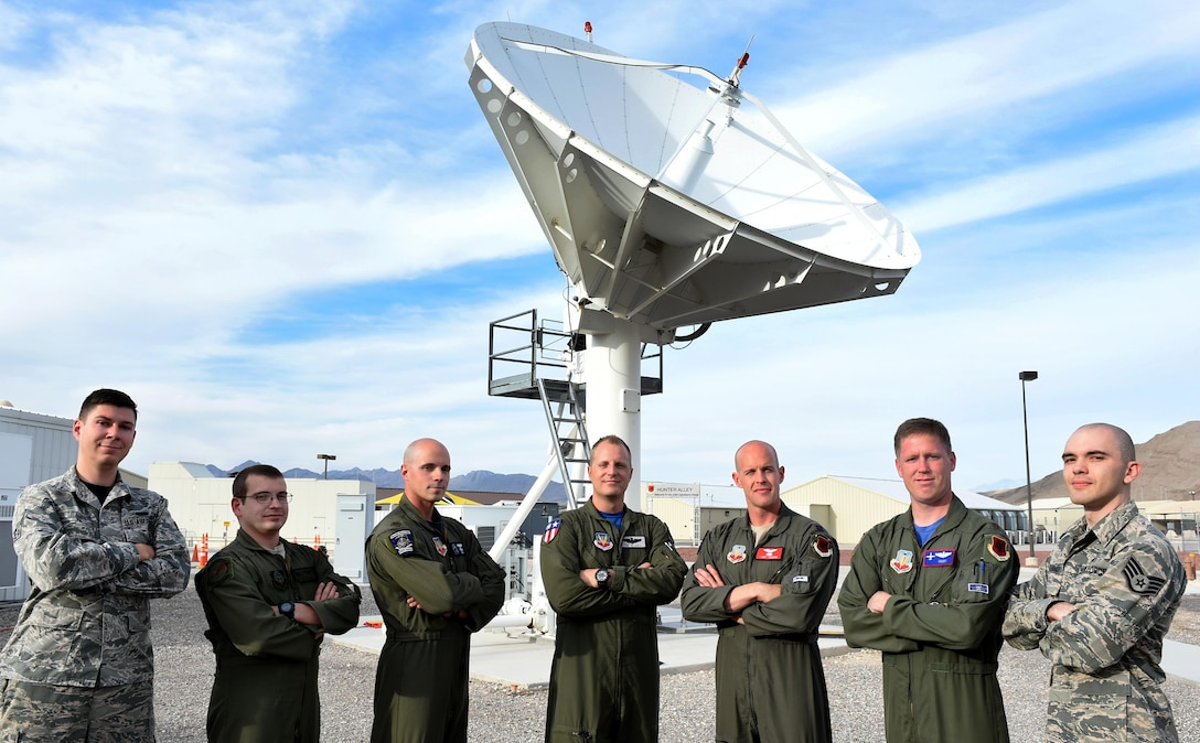 Airmen from the 432nd Wing/432nd Air Expeditionary Wing pose with their instructor, Capt. Craig, 26th Weapon Squadron MQ-9 Pilot (center), after graduating from the U.S. Air Force's first-ever Electronic Combat Officers course. The course focuses on training aircrews of MQ-1 Predator and MQ-9 Reaper aircraft to mitigate potential signal interruptions thus reducing the potential risks to RPAs. (U.S. Air Force photo by Tech. Sgt. Nadine Barclay)
