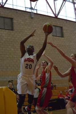 "U.S. Seaman Shaniqua ""Mo"" Bennett goes in for a layup against Canadian defenders during the first day of the World Military Women's Basketball Championship at Camp Pendleton, Calif., July 25, 2016. Bennett scored 11 points in the game and USA beat Canada 82-25."