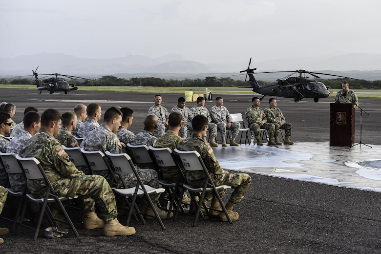 U.S. Army Capt. Cody Thompson, 1st Battalion, 228th Aviation Regiment Alpha Company commander, speaks during a memorial service for U.S. Army Spc. Kyle Gantt at Soto Cano Air Base, Honduras, July 24, 2016. The common theme that was repeated by all who spoke about Gantt was that of his sense of humor and ability to make everyone smile. (U.S. Air Force photo by Staff Sgt. Siuta B. Ika)