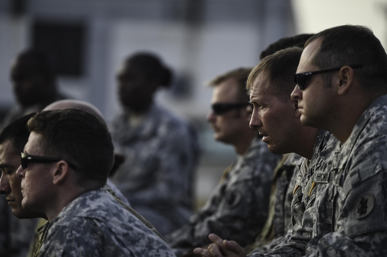 Members of Joint Task Force-Bravo listen to speeches honoring the life and service of U.S. Army Spc. Kyle Gantt during Gantt's memorial service at Soto Cano Air Base, Honduras, July 24, 2016. More than 300 members of the Soto Cano community attended the ceremony to honor Gantt's life and service. (U.S. Air Force photo by Staff Sgt. Siuta B. Ika)