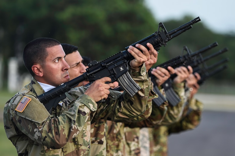 Members of the Joint Task Force-Bravo Honor Guard perform a 21-gun salute during a memorial service for U.S. Army Spc. Kyle Gantt at Soto Cano Air Base, Honduras, July 24, 2016. Gantt, who was raised in Piqua, Ohio, enlisted in the Army in February 2012. (U.S. Air Force photo by Staff Sgt. Siuta B. Ika)