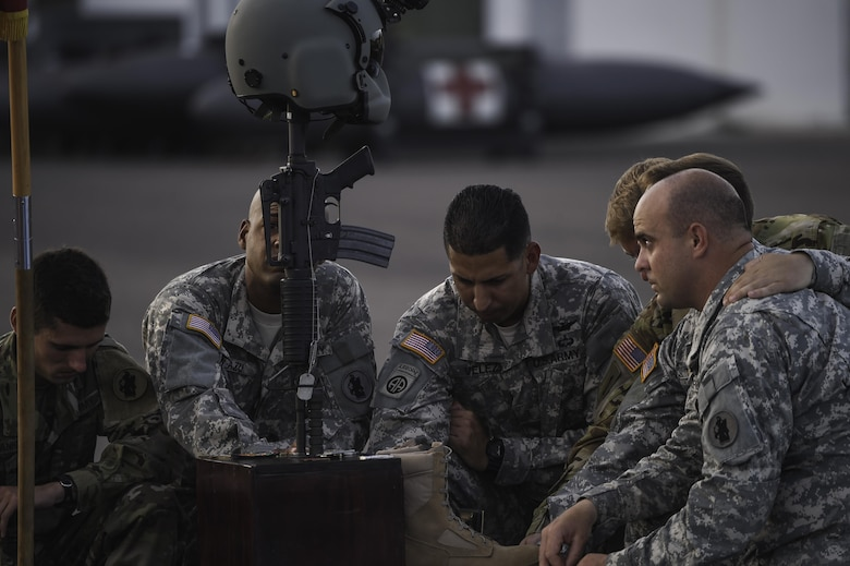 Members of the 1st Battalion, 228th Aviation Regiment pay their respects to U.S. Army Spc. Kyle Gantt during Gantt's memorial service at Soto Cano Air Base, Honduras, July 24, 2016. Gantt, who was raised in Piqua, Ohio, enlisted in the Army in February 2012. (U.S. Air Force photo by Staff Sgt. Siuta B. Ika)