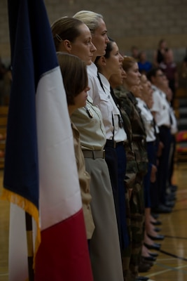 Members of the French military women's basketball team stand at attention during the playing of the 2016 Conseil International Du Sport Militaire (CISM) anthem July 25 at Camp Pendleton, California. The base is hosting the CISM World Military Women's Basketball Championship July 25 to July 29 to promote peace activities and solidarity among military athletes through sports. (U.S. Marine Corps photo by Sgt. Abbey Perria)