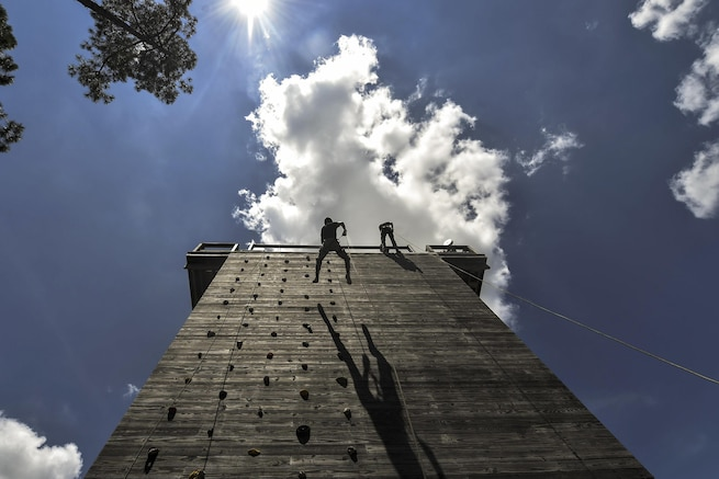 Junior ROTC cadets rappel down a 40-foot tower at Hurlburt Field, Fla., July 20, 2016. Special tactics airmen worked with 60 cadets from five high schools during a weeklong summer leadership course. Air Force photo by Senior Airman Ryan Conroy