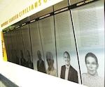 Judith C. Gilliom's photo and story are featured along with those of several other distinguished Defense Department civilian employees at a wall-mounted display in the Pentagon. Gilliom, a noted advocate for disabled employees and workforce diversity, died Oct. 15, 2008. DoD photo by Gerry J. Gilmore