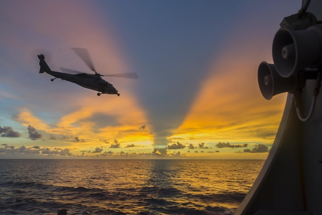 An MH-60S Seahawk helicopter departs from the flight deck of the guided-missile destroyer USS McCampbell during visit, board, search and seizure training in the South China Sea, July 22, 2016. The McCampbell is supporting security in the Indo-Asia-Pacific region. Navy photo by Petty Officer 3rd Class Elesia K. Patten