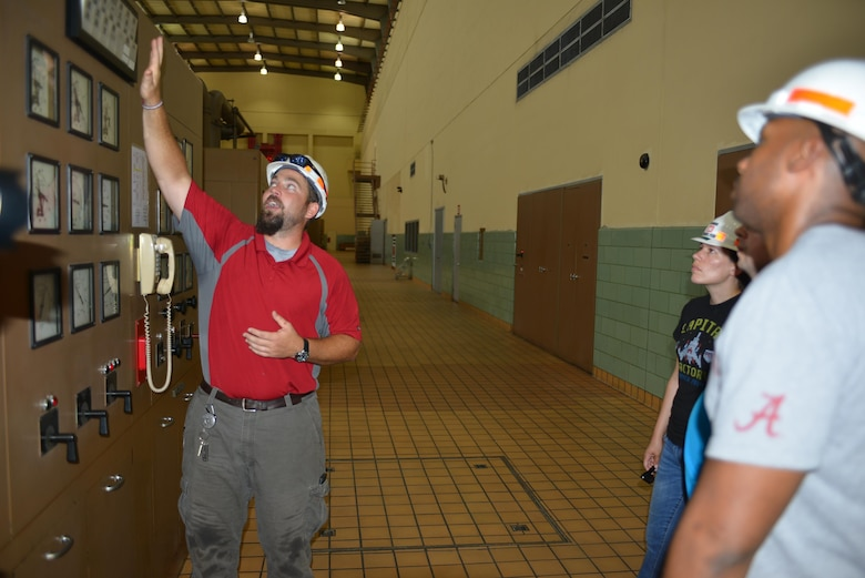 John Bell, a hydropower engineer at the Old Hickory Power Plant in Hendersonville, Tenn., explains gages and generation to Stratford STEM High School teachers during an externship with the U.S. Army Corps of Engineers Nashville District July 21, 2016.