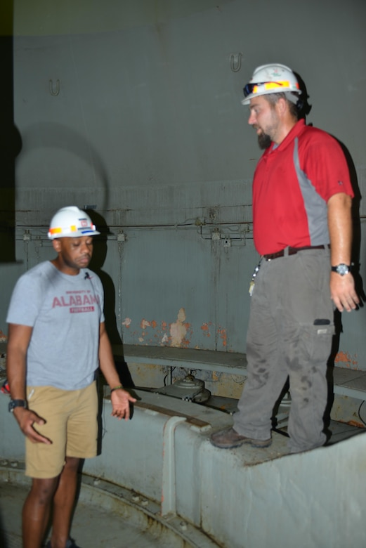 John Bell, hydropower engineer at the Old Hickory Power Plant in Hendersonville, Tenn., explains how water circulates at the dam and how it is managed to Stratford STEM High School teachers during an externship with the U.S. Army Corps of Engineers Nashville District July 21, 2016.