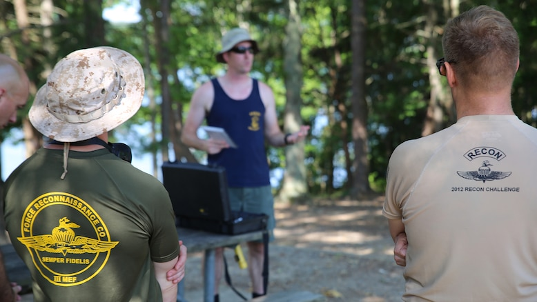 Navy Diver First Class Jason Young (center), Marine Corps Systems Command diving officer with Reconnaissance and Amphibious Raids, gives a safety briefing prior to a dive July 18 at Lake Anna in Spotsylvania, Virginia. The RAR team worked with several Marine combatant divers to conduct tests of potential upgrades to the Diver Propulsion Device to improve its speed and controllability.