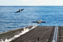F/A-18E Super Hornets assigned to Strike Fighter Squadron 151 and 41 launch from the flight deck of the USS John C. Stennis during Rim of the Pacific 2016 in the Pacific Ocean, July 18, 2016. The maritime exercise involves about 25,000 participants from 26 nations, 49 ships, six submarines and about 200 aircraft. Navy photo by Petty Officer 3rd Class Jake Greenberg