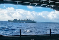 The fast combat support ship USNS Rainier steams alongside the USS John C. Stennis during Rim of the Pacific 2016 in the Pacific Ocean, July 18, 2016. Navy photo by Petty Officer 3rd Class Tomas Compian