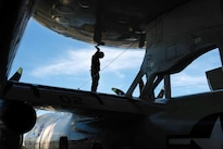 Navy Seaman Justin Keeter performs preflight checks on an E-2C Hawkeye aircraft assigned to the Airborne Early Warning Squadron 112 aboard the USS John C. Stennis during Rim of the Pacific 2016 in the Pacific Ocean, July 20, 2016. Keeter is an aviation structural mechanic safety equipment airman. Navy photo by Petty Officer 3rd Class Andre T. Richard