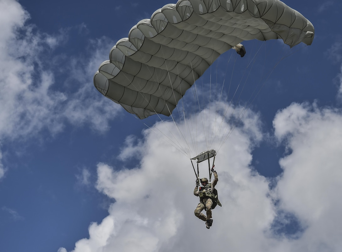 Special Tactics Training Squadron students perform military freefall training at Eglin Range, Fla., June 3, 2016. Special Tactics Airmen, the Air Force's ground special operations force, establish air fields and drop zone for follow-on forces after freefalling in to infiltrate into hostile or austere territory. (U.S. Air Force photo by Senior Airman Ryan Conroy)