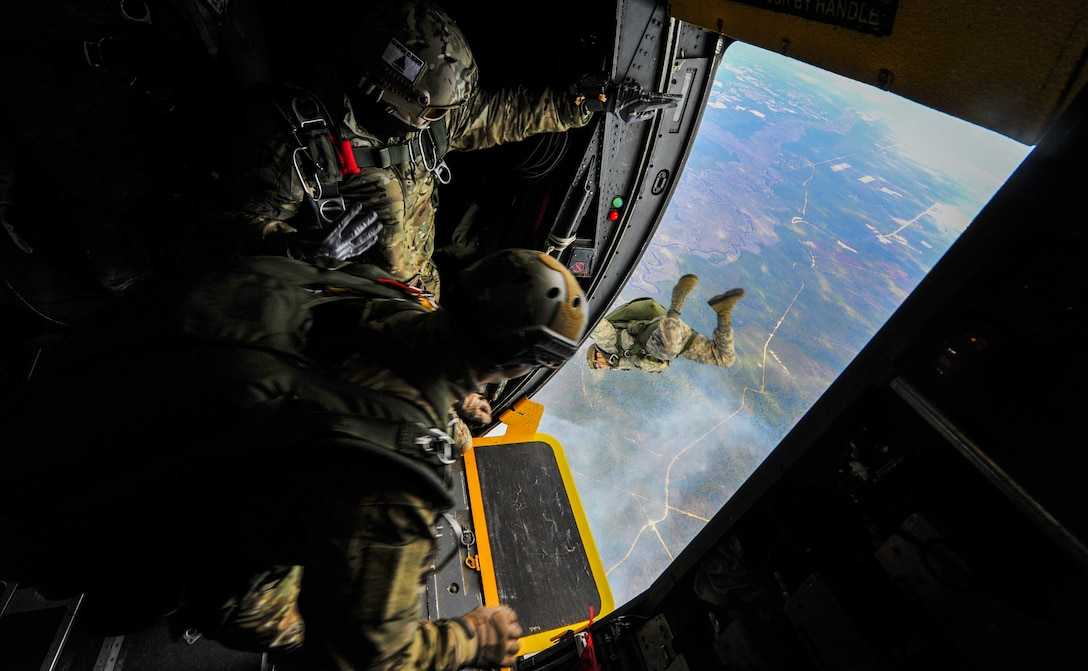 Special Tactics Airmen jump out of the door of a MC-130 Talon II  as an alternate insertion into hostile or austere environments, when aircraft cannot land in enemy territory or rough terrain. The Special Tactics Airmen train to land safely in a planned drop zone and conduct their mission, whether it be personnel recovery, airfield reconnaissance and establishment or special operations air integration. (U.S. Air Force photo by Staff Sgt. Christopher Callaway)