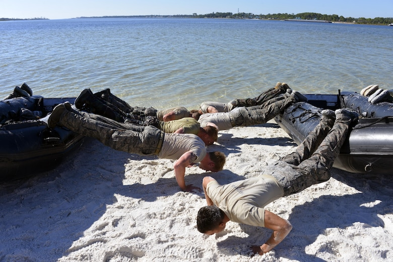Special Tactics officer candidates perform pushups on a Zodiac boat during a selection at Hurlburt Field, Fla., Oct. 21, 2014. Special Tactics career field training pipelines are some of the most physically and psychologically challenging in the Air Force. To ensure the correct individuals are on the battlefield, a group of Special Tactics Airmen weed out the cross-training candidates who don't meet the high standards, putting them through a week-long selection process to select only the best-qualified individuals. (U.S. Air Force photo by 1st Lt. Katrina Cheesman)