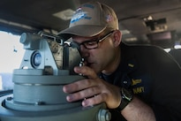 Navy Ensign John Barmann looks through a telescopic alidade, a sighting device, aboard the USS John C. Stennis navigation bridge during Rim of the Pacific 2016 in the Pacific Ocean, July 21, 2016. Navy photo by Petty Officer 3rd Class Kenneth Rodriguez Santiago