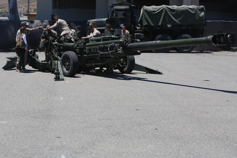 Marines answer questions about the M777A2 Howitzer during a Jane Wayne Day event on Camp Pendleton, Calif., July 16, 2016. The event included multiple live fire exercises, static displays of vehicles, weapons and helicopters, and a barbecue. (U.S. Marine Corps photo by Lance Cpl. Shellie Hall)