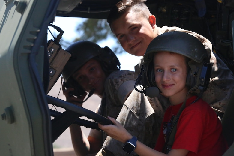 A boy sits in a logistics vehicle system during a Jane Wayne Day event on Camp Pendleton, Calif., July 16, 2016. The Jane Wayne Day event gives Marines and their families a chance to bond while becoming familiar with what the Marines experience through hands-on events and live fire exercises. (U.S. Marine Corps photo by Lance Cpl. Shellie Hall)