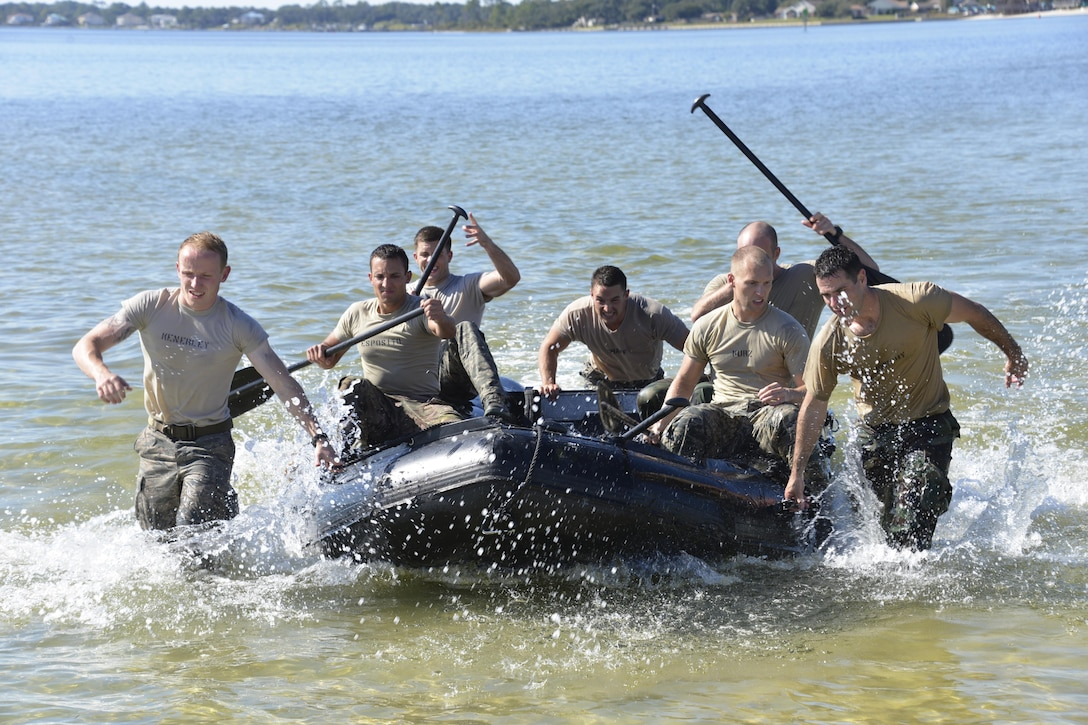 Special Tactics officer candidates pull a Zodiac boat to the shore during a selection at Hurlburt Field, Fla., Oct. 21, 2014. Special Tactics career field training pipelines are some of the most physically and psychologically challenging in the Air Force. To ensure the correct individuals are on the battlefield, a group of Special Tactics Airmen weed out the cross-training candidates who don't meet the high standards, putting them through a week-long selection process to select only the best-qualified individuals. (U.S. Air Force photo by 1st Lt. Katrina Cheesman)