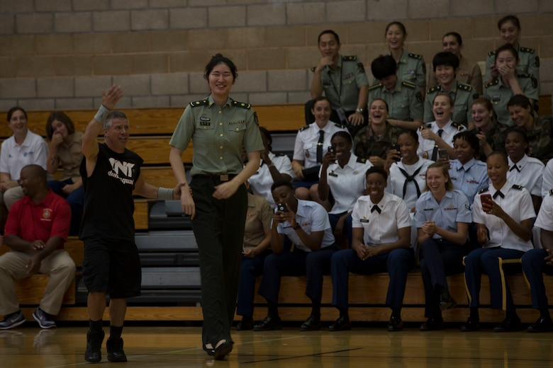 A member from the Chinese military women's basketball team volunteers to participate in the opening ceremony for the 2016 Conseil International Du Sport Militaire (CISM) World Military Women's Basketball Championship July 25 at Camp Pendleton, California. Camp Pendleton is hosting the 2016 CISM World Military Women's Basketball Championship tournament July 25 through July 29 to promote peace activities and solidarity among athletes through sports. (U.S. Marine Corps photo by Sgt. Abbey Perria)