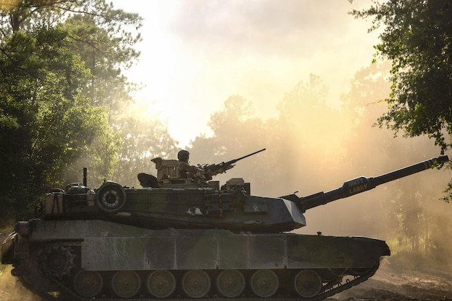An M1A1 Abrams tank drives down a dirt road during a training event on Camp Lejeune, N.C., July 21, 2016. The event brought together active and reserve Marines to train for possible future deployment. Marine Corps photo by Sgt. Matthew Callahan
