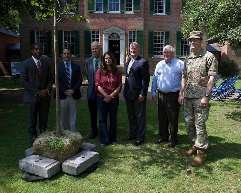 Project team members, property owner John Walton and  Col. Edward Chamberlayne, commander, U.S. Army Corps of Engineers, Baltimore District gather around the commemorative Sycamore tree during the commemoration of the Piscataway Creek Wetlands Mitigation Project at Poplar Hill Mansion in Clinton, Md., June 30, 2016. The Corps of Engineers has supported Joint Base Andrews in identifying an acceptable wetland mitigation site since 2010.