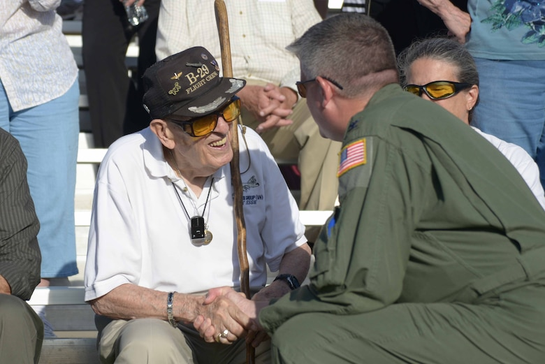Charles Chauncey, a World War II B-29 Superfortress pilot, speaks with Col. Albert Miller, 22nd Air Refueling Wing commander, at the first flight of 'Doc,' a B-29, July 17, 2016, at McConnell Air Force Base, Kan. Chauncey flew 35 missions over Japan in a B-29 nicknamed 'Goin' Jessie' during World War II, and earned the Distinguished Flying Cross after losing an engine during a mission. (U.S. Air Force photo/Airman 1st Class Christopher Thornbury)