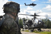 An AH-64 Apache attack helicopter lands on a road near defensive positions held by A Company, 1st Battalion, 24th Infantry Regiment, 1st Stryker Brigade Combat Team, 25th Infantry Division, U.S. Army Alaska, during a coordinated Opposing Forces attack in Donnelly Training Area near Ft. Greely, Alaska in the Arctic Anvil exercise, Monday, July 25, 2016. Arctic Anvil is a joint, multinational exercise which includes forces from USARAK's 1st Stryker Brigade Combat Team, 25th Infantry Division and UATF, along with forces from the 196th Infantry Brigade's Joint Pacific Multinational Readiness Capability, the Iowa National Guard's 133rd Infantry Regiment and the 1st Battalion, Princess Patricia's Canadian Light Infantry. (U.S. Air Force photo/Justin Connaher)