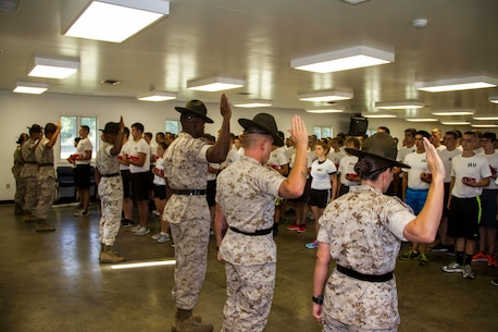 Seven Drill Instructors from Marine Corps Recruit Depot Parris Island, S.C., and San Diego, Calif., recite the Drill Instructor Creed before the commencing of Recruiting Station Lansing, Mich., Mini Boot Camp, July 15, 2016.  Mini Boot Camp serves to better prepare Marine Corps Poolees for the rigors of recruit training.