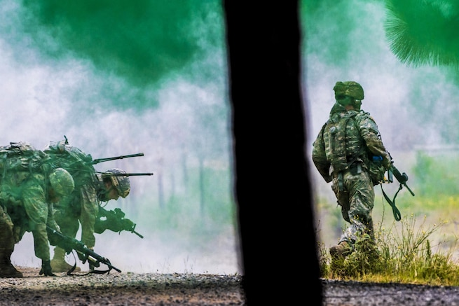 Soldiers advance through a smoke screen during live-fire training at the Joint Readiness Training Center in Fort Polk, La., July 25, 2016. The soldiers are assigned to the New York Army National Guard's Company C, 1st Battalion, 69th Infantry Regiment. Army National Guard photo by Sgt. Harley Jelis