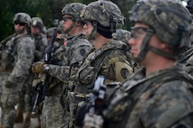 Soldiers assigned to 1st Battalion, 5th Infantry Regiment, 1st Stryker Brigade Combat Team, 25th Infantry Division, U.S. Army Alaska, listen to a briefing before a company live-fire in the Yukon Training Area near Fort Wainwright, Alaska, during the Arctic Anvil 2016 exercise, Saturday, July 23, 2016. Arctic Anvil is a joint, multinational exercise which includes forces from USARAK's 1st Stryker Brigade Combat Team, 25th Infantry Division and UATF, along with forces from the 196th Infantry Brigade's Joint Pacific Multinational Readiness Capability, the Iowa National Guard's 133rd Infantry Regiment and the 1st Battalion, Princess Patricia's Canadian Light Infantry. (U.S. Air Force photo/Justin Connaher)