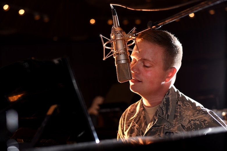 Airman 1st Class Jamie Teachenor, U.S. Air Force Academy Band and Wild Blue Country lead vocalist, rehearses his songs at Peterson Air Force Base, Colo., on July 20, 2016. Before joining the Air Force, Teachenor was a multi-platinum singer and songwriter based in Nashville, Tennessee. (U.S. Air Force photo by Airman 1st Class Dennis Hoffman)