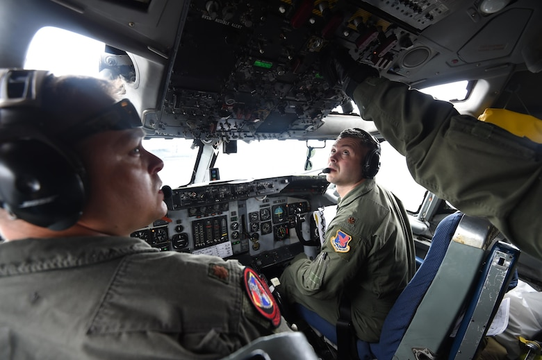 Maj. Matt Portno, right, and Maj. Shawn Kilbourne, left, complete pre-flight checklists aboard an E-3 Sentry July 23, 2016, at Joint Base Pearl Harbor-Hickam, Hawaii, in support of Rim of the Pacific 2016. More than 125 Airmen from the 513th Air Control Group and 552nd Air Control Wing are deployed to Hawaii in support of the RIMPAC 2016 exercise. Twenty-six nations, more than 40 ships and submarines, more than 200 aircraft and 25,000 personnel are participating in RIMPAC from June 30 to Aug. 4, in and around the Hawaiian Islands and Southern California. The world's largest international maritime exercise, RIMPAC provides a unique training opportunity that helps participants foster and sustain the cooperative relationships that are critical to ensuring the safety of sea lanes and security on the world's oceans. RIMPAC 2016 is the 25th exercise in the series that began in 1971. (U.S. Air Force photo by 2nd Lt. Caleb Wanzer)