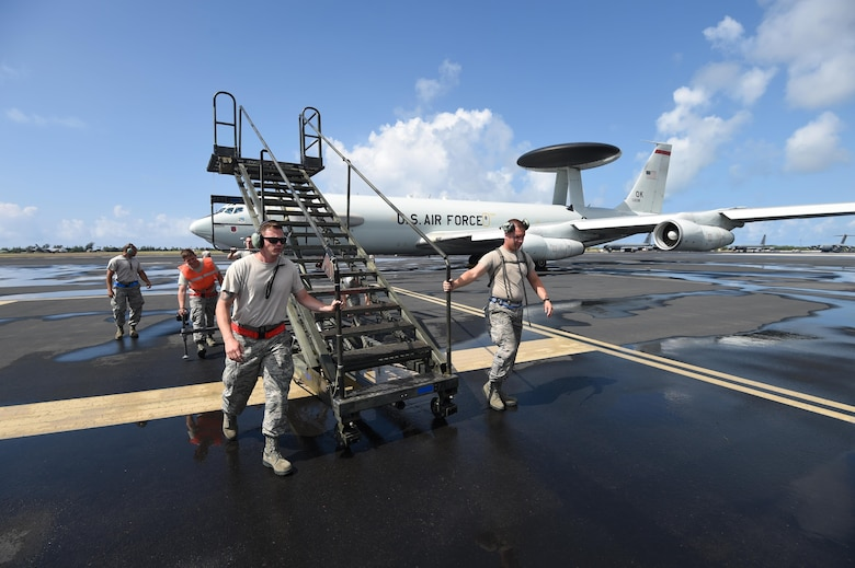 Maintenance Reservists from the 513th Aircraft Maintenance Squadron roll stairs away from an E-3 Sentry on July 19, 2016, at Joint Base Pearl Harbor-Hickam, Hawaii. More than 125 Airmen from the 513th Air Control Group and 552nd Air Control Wing are deployed to Hawaii in support of the Rim of the Pacific 2016 exercise. Twenty-six nations, more than 40 ships and submarines, more than 200 aircraft and 25,000 personnel are participating in RIMPAC from June 30 to Aug. 4, in and around the Hawaiian Islands and Southern California. The world's largest international maritime exercise, RIMPAC provides a unique training opportunity that helps participants foster and sustain the cooperative relationships that are critical to ensuring the safety of sea lanes and security on the world's oceans. RIMPAC 2016 is the 25th exercise in the series that began in 1971. (U.S. Air Force photo by 2nd Lt. Caleb Wanzer)