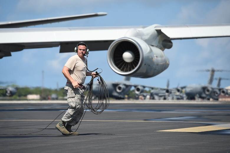 Tech. Sgt. Robert Adams, a crew chief assigned to the 513th Aircraft Maintenance Squadron, moves to safety July 19, 2016, at Joint Base Pearl Harbor-Hickam, Hawaii, as an E-3 Sentry flown by Reservists from the 513th Air Control Group prepares to taxi before a mission in support of Rim of the Pacific 2016. More than 125 Airmen from the 513th Air Control Group and 552nd Air Control Wing are deployed to Hawaii in support of the RIMPAC 2016 exercise. Twenty-six nations, more than 40 ships and submarines, more than 200 aircraft and 25,000 personnel are participating in RIMPAC from June 30 to Aug. 4, in and around the Hawaiian Islands and Southern California. The world's largest international maritime exercise, RIMPAC provides a unique training opportunity that helps participants foster and sustain the cooperative relationships that are critical to ensuring the safety of sea lanes and security on the world's oceans. RIMPAC 2016 is the 25th exercise in the series that began in 1971. (U.S. Air Force photo by 2nd Lt. Caleb Wanzer)
