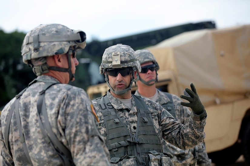 Lt. Col. Daniel Jaquint, battalion commander of the 1st Battalion, 383rd Regiment, 181st Infantry Brigade, briefs Col. Robert Cooley, deputy commander for the 85th Support Command, about 1-383 operations at Warrior Exercise 86-16-03 during a visit to forward operating (training) base Liberty, Fort McCoy, Wisconsin, July 11, 2016. (U.S. Army photo by Mr. Anthony L. Taylor/Released)