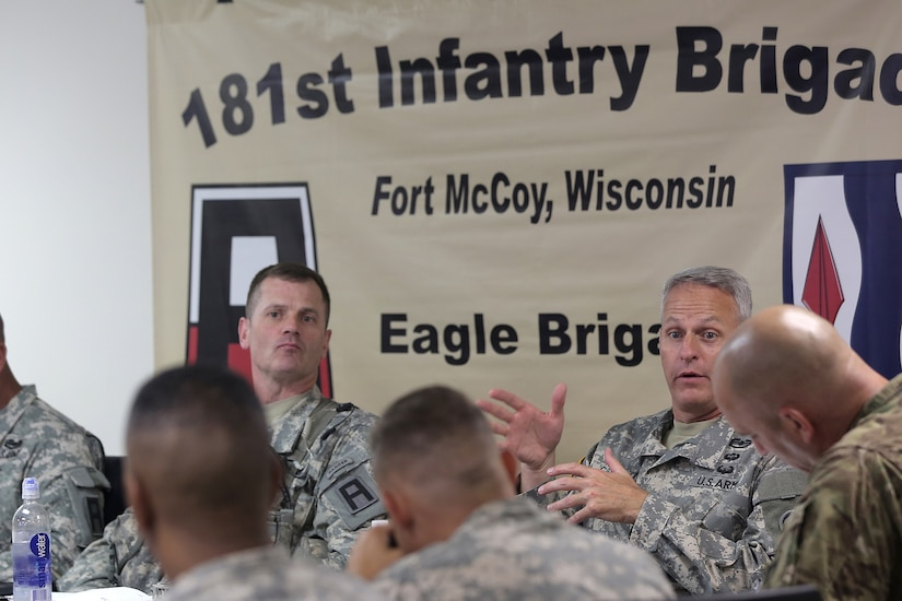 Col. John Cook, left, Commander, 181st Infantry Brigade, listens as Col. Robert Cooley, deputy commander for the 85th Support Command, gives remarks during a battle update brief at the 181 INF BDE headquarters, July 11, 2016, at Warrior Exercise 86-16-03, Fort McCoy, Wisconsin. (U.S. Army photo by Mr. Anthony L. Taylor/Released)