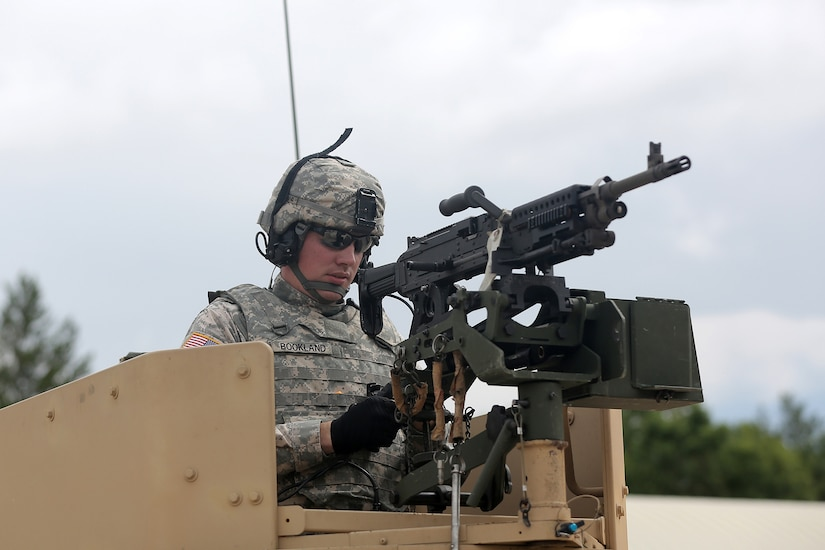Spc. Jeremy Bookland, Information Technology Specialist assigned to the 206th Regional Support Group, Springfield, Illinois, stands in his Humvee weapon mount after returning from the live-fire proof of principle training, July 12, 2016, at Warrior Exercise 86-16-03, Fort McCoy, Wisconsin. (U.S. Army photo by Mr. Anthony L. Taylor/Released)