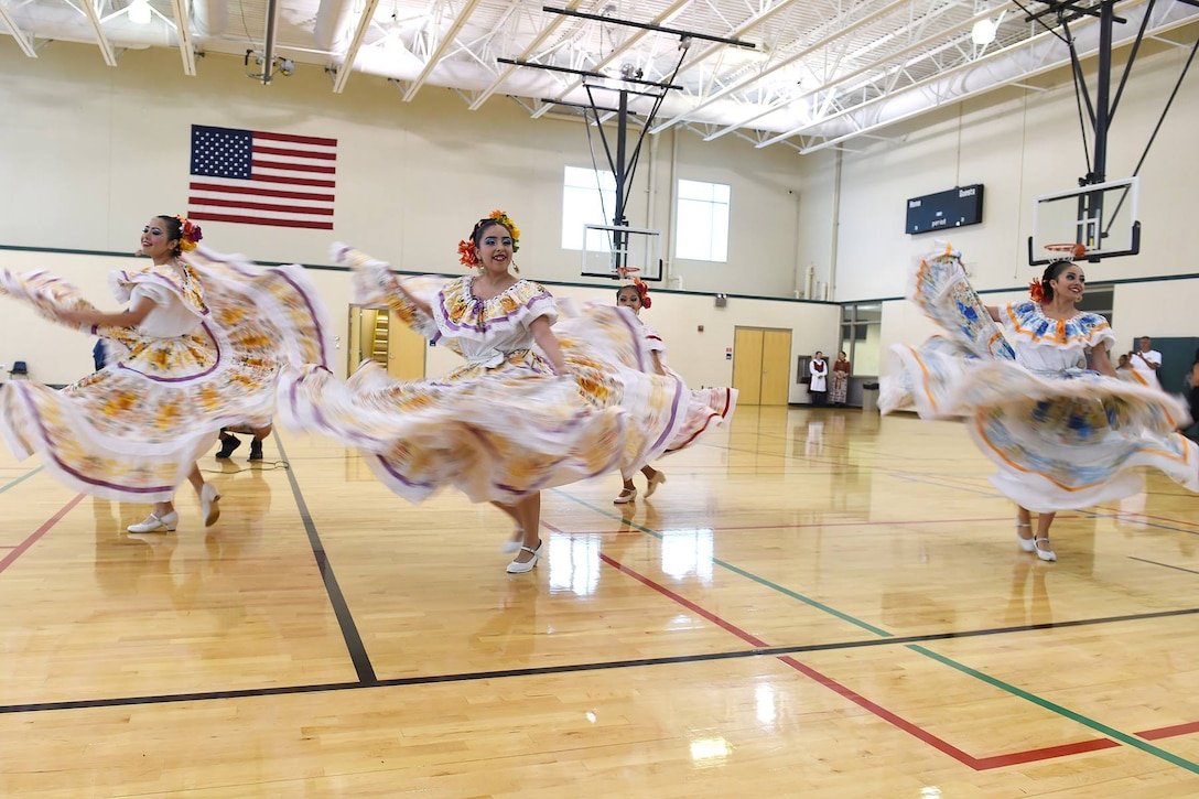Members of the Chicago Mexican Folkloric Dance Group perform during the 85th Support Command's Family Day Equal Opportunity Diversity Event. (Photo by Sgt. Aaron Berogan)