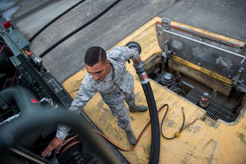 Airman Seth Roy, 628th Logistic Readiness Squadron fuels distribution operator, puts away a fuel hose July 18, 2016, at Joint Base Charleston, S.C. Last year, over 50 Airmen of the 628th LRS fuels flight provided the base with more than 36 million gallons of fuel for missions throughout the base. (U.S. Air Force photo/Staff Sgt. Jared Trimarchi)