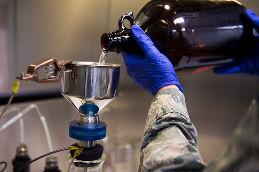 Senior Airman Wesley Watkins checks for contaminants in jet fuel inside the 628th Logistic Readiness Squadron fuels laboratory, July 11, 2016 at Joint Base Charleston, S.C. Last year, over 50 Airmen of the 628th Logistics Readiness Squadron fuels flight provided the base with more than 36 million gallons of fuel for missions throughout the base. (U.S. Air Force photo/Staff Sgt. Jared Trimarchi)